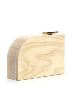 Lanvin  This wooden piece will perfectly complement minimal after-dark outfits.  £1,070, Lanvin,