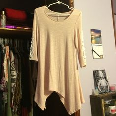 Light pink tunic Wear with leggings, 3/4 length sleeves, lace on the sleeve, never worn -just tried on, purchased from The Mint Julep online. Perfect condition. Size small but I fine runs a medium. The Mint Julep  Tops Tunics