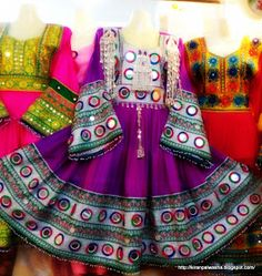 One's destination is never a place but a new way of seeing things.: Fancy Afghani and Kuchi style frocks