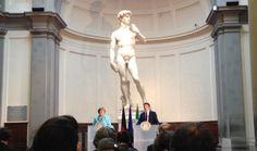 At the foot of the world-famous Michelangelo's David in the Accademia Gallery, an unusual press room in Florence, Italy, hosted the Prime Minister Matteo Renzi and the German Chancellor Angela Merkel.