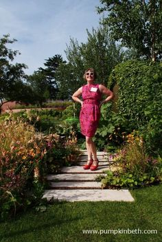 Ann-Marie Powell in her Gold Medal winning Macmillan Legacy Garden. The garden was built by The Outdoor Room and sponsored by Macmillan Cancer support
