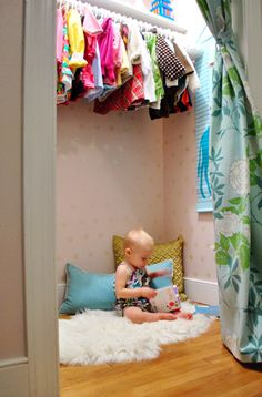 Love the wall decor, but mostly I'm digging the idea of an open closet, high hangers and room on the bottom for play.