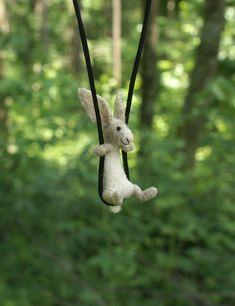 Needle felted rabbit necklace by motleymutton on Etsy