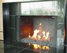 Tile fireplace. gotta love them! in winter that's how we keep warm!:)