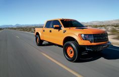2012-ford-f-150-svt-raptor-front-view-in-motion