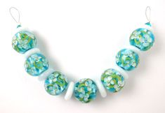 White on Aqua on silver disk spacers - Lampwork beads by Corina Tettinger / Corinabeads