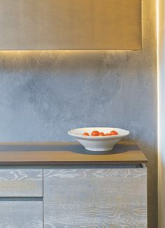 A slim, slightly raised surface gives the impression of floating.These Urbo cabinets in mid grey Driftwood veneer are topped with 20mm Keranium Dekton. Roundhouse's bespoke Urbo kitchens start at £30,000.