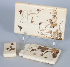 Two Japanese inlaid ivory cases  late 19th century; calling card case with inlaid gilt lacquered birds, insects, and flowers, 4 in. L., 2 1/2 in. W., and a needle case with similar decoration, 3 1/4 in. L., 1 3/4 in. W.