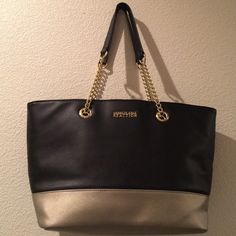 """Kenneth Cole Reaction Tote Kenneth Cole Reaction Tote- Black/ Semi Gold. Excellent Condition. 2 slip pockets and 1 zipper pocket. Snaps Close. The strap is 10.25"""" drop. Dimensions: 9.75"""" H x 15.5"""" W x 6""""D. Kenneth Cole Reaction Bags Totes"""