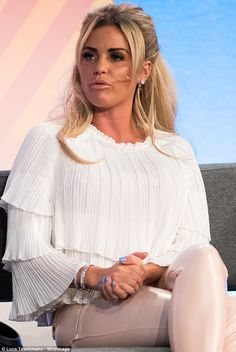 Style and skill: Katie Price, 38, made a girly and glamorous display in pink leather trous...