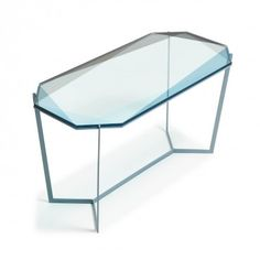 gemstones for the home - bevel-cut glass tables set on metal legs emulate the reflection and transparency of faceted jewels, refracting light onto the surfaces they occupy. handmade by Debra Folz in her Boston studio, these modular geometric pieces allow for sculptural arrangements.