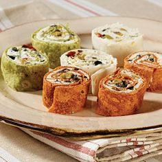 Touchdown Pinwheels | MyRecipes.com - There is a whole lot of flavor wrapped up in these colorful little pinwheels. You can serve them cold as appetizers or a fun snack.