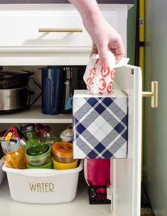 Why is it that whenever you need a bag for a last-minute lunch or wet bathing suit, there's never one in sight? Stuff them in an empty tissue box on the back of a cabinet door so you're never left hunting one down again. Click through for the tutorial and more cabinet door storage ideas.