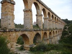Archaeological Ensemble of Tárraco. Aqueduct of Tárraco. Tarragona,	Catalonia in Spain.	1st to 4th centuries.	875. World Heritage Site since 2000. The prominent Roman city of Tárraco at the site of modern-day Tarragona, served as the capital of the provinces of Hispania Citerior and later Hispania Tarraconensis. The amphitheatre was constructed in the 2nd century. Most remains are only fragments or preserved under more modern buildings.