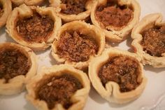 Waterloo County's Most Coveted Butter Tarts - - Never mind land and riches, Peggy Nagle married into a far better dynasty: butter tarts. Lynn Crawford scored the winning recipe at her local quilting bee. Recipe For Butter Tarts, Canadian Butter Tarts, Tart Recipes, Cookbook Recipes, Sweet Recipes, Pie Dessert, Dessert Recipes, Dessert Table, Dessert Book