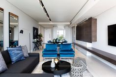 A final look at our Embassy Towers living room scheme; charcoal greys, grounded with black and white and accented with shades and tones of petrol blue, make for a calm and serene space. If we have to be locked down for 7 hundred and 69 thousand 8 hundred and 20 and 70 days, it would be nice to spend it here! 💙🤍🖤 To have your space #CuratedByCopperleaf, please visit our website for more information. Link in bio. 📷 @annalizenelphotography… Living Room Grey, Your Space, Charcoal, Shades, Couch, Black And White, Studio, Towers, Blue