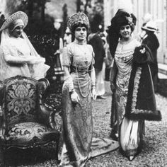 Princess Paley (right) wearing a diamond diadem with a 27 carat pear shaped center stone as a corsage garland and a diamond and pearl stomacher as a hat badge--both by Cartier. Fancy dress ball in Paris. forum.alexanderpalace.