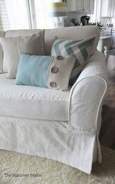 Cottage-style slipcover custom made in cotton poly canvas.