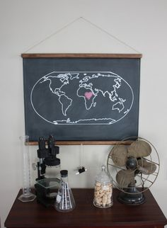"hmmmm maybe chalkboard map for Kstar's office space. do map permanent ink and title it ""Where in the world is Kristy Stark"" and she can red/pink heart where she currently is (or about to go to next). we can diy a cuter version of this!"