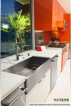 Bold cabinets are a truly modern twist on the timeless all-white kitchen. The stunning Prestige Stainless finish of the Heritage Farmhouse Sink beautifully completes this modern fusion of bold colors with a classic style. Are you a fan of bold colors in your kitchen or do you prefer the all-white look? #kitchencolor #hgtv #kitchenprojects #luxuryhome #interiordesign #modernkitchen #interiordesign Stainless Steel Farmhouse Sink, Stainless Steel Cleaner, Stainless Steel Types, Stainless Steel Sinks, Stainless Kitchen, Farmhouse Aprons, Farmhouse Sinks, Apron Front Sink, Timeless Kitchen