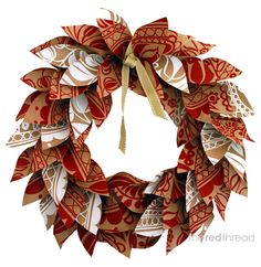 Fun paper Christmas wreath, maybe for the front door, can use wrapping paper, scrapbook paper, etc.