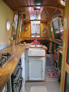 Canal Boat interior. Love the Belfast sink. #canal #narrowboat shaped splash back
