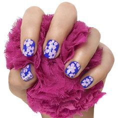 in full bloom by essie - florals aren't just for dresses anymore. a fistful of flowers nails a manicure look with serious fashion caché.