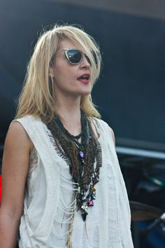 Emily Haines of Metric in Miu Miu sunnies. Obsessed with those sunglasses...if only I had $400 to spend on them...and could find them in stock anywhere...