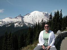 Sally Kuhn Sennert of the Smithsonian's Global Volcanism Program in front of Mount Rainier, Washington.
