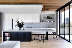 Triple Kick in black in the Holly Penthouse. Interior design by Triple Kick in black in the Holly Penthouse. Interior design by for Styling by Simone Haag and… - Door Rustic Kitchen, New Kitchen, Kitchen Decor, Awesome Kitchen, Kitchen Ideas, Kitchen Island With Bar, Waterfall Kitchen Island, Kitchen Island Seating, Kitchen Island Storage