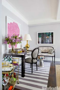 OPT FOR DOUBLE-DUTY FURNITURE – When entertaining, this desk becomes a dining table in a Manhattan apartment designed by Ashley Whittaker. Click through for the entire gallery and for more small living room ideas.