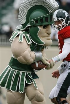 Sparty taking a snap at the spring football game #spartans