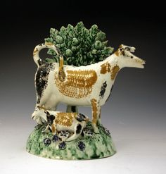 POTTERY COW CREAMER WITH BOCAGE CIRCA 1810