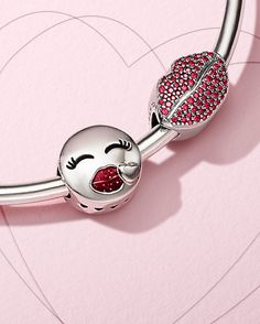 Seal your bracelet stylings with a kiss this Valentine's Day. Soon in stores, these vibrant emoji-inspired charms speak the language of love in the sweetest of ways.
