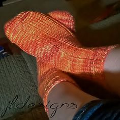 """Keep your feet and toes warm and toasty with these socks made on the 36 peg 3/8"""" Adult Small/Youth Glove & Sock loom and roughly 170-200 yards of worsted weight yarn (sample uses less than 1 ball of cascade pacific multi in color flame). These socks make an amazing pair of winter socks to wear with boots or for lighter weight socks you can use dk or sport weight (#2 or #3) yarn. This is a great pattern for both those experienced and beginning with loom knitting socks."""