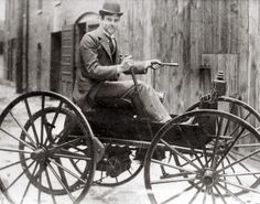 John D. Perry Lewis and his battery powered horseless vehicle, the first in St. Louis. (1893)