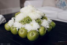 A unique floral arrangement of green apples and white mums. Unique floral ideas, home party centerpiece ideas. Party Centerpieces, Centerpiece Ideas, Table Decorations, White Mums, House Party, Apples, Floral Arrangements, Florals, Floral Design