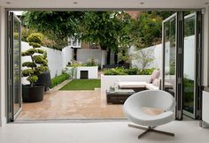 Loving the faux grass inset into the pavers. Low maintenance and practical in a small shady courtyard