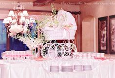 Beautiful centerpiece for a baby shower...flowers in the baby carriage.