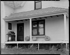 Front porch of a farmhouse ready for Halloween,nearElderon,Wisconsin, 1994, by John N. Vogel for an Historic American Building Survey (HABS), viaLibrary of Congress Prints and Photographs Divis…