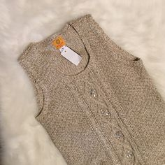 Embellished sweater tank Never worn. With tags! Small hole in bottom (last pic) that can be easily fixed! All of the rhinestones are attached. Great for work or a night out to dinner! Very soft! Ruby Rd. Sweaters Crew & Scoop Necks