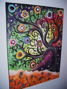Painted canvas with button details on the flowers.  LOVE!