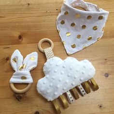 Your place to buy and sell all things handmade - Beautiful neutral white and gold baby shower set Bea'spoke cloud gold ribbon tag taggie plush lovey baby neutral white dot bib teether crib toy plushie minky clouds nursery shower gift - Crib Toys, Baby Toys, Handgemachtes Baby, Baby Set, Diy Bebe, Baby Accessoires, Baby Sewing Projects, Gold Baby Showers, Creation Couture
