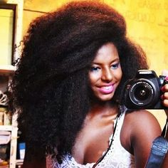 http://www.shorthaircutsforblackwomen.com/natural_hair-products/ Long natural hair is beautiful in every texture. Love how she celebrates her texture and length.