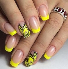 Creative Yellow Themed French Tip Nail Art Design. This half yellow and black flower and the yellow french tips is another very creative and simple yellow nail art design to go with. You can try this one out with any of your beach party costume and just look sassy.