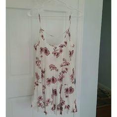 Brandy jada floral dress Backless dress, perfect condition BNWOT. still has plastic tab. Adjustable straps. Brandy Melville Dresses Backless