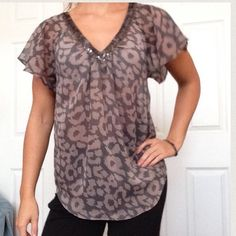 Express Blouse semi sheer shirt Great condition sequined and beaded neckline and neutral leopard pattern. Flowing short sleeves, somewhat sheer. Small pin head sized white mark under neckline barely visible when worn! From clean smoke and pet free house! Open to offers and trades✨ Express Tops Blouses