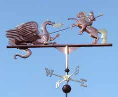 This weathervane depicts St George astride his horse, battling a firebreathing dragon. Made from copper and brass, with optional gold leafing.