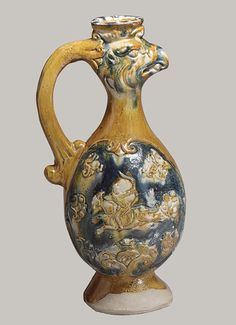 Phoenix-headed ewer, Tang dynasty (618–906), late 7th–first half of 8th century - China - Earthenware with three-color (sancai) glaze