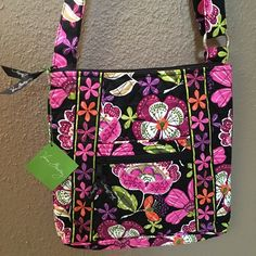 Hipster Handbag Brand New Hipster Handbag by Vera Bradley. Bright and cheery pink, purple, orange & green floral print looks stunning against the jet black background. Zipper opening on top; along with zippered pockets on the front and back. Strap is adjustable.  Retails for $60 Vera Bradley Bags Shoulder Bags